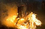 Las Luminarias, in the small village of San Bartolome de Pinares, Spain. In honor of San Anton, the patron saint of animals, horses are riden through the bonfires on the night before the official day of honoring animals in Spain. .En San Bartolome de Pinares, España, se celebran las Luminarias en la fiesta de San Anton, patron de los animales, jinetes con sus caballos atraviesan grandes fogatas encendidas por la noche en las calles del pueblo. foto: © Jose Luis Cuesta