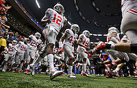 Ohio State Buckeyes quarterback Cardale Jones (12) and Ohio State Buckeyes linebacker Darron Lee (43) enter the field before the start of the Allstate Sugar Bowl college football Playoff Semifinal game against Alabama Crimson Tide at the Mercedes-Benz Superdome in New Orleans, Louisiana on January 1, 2015.  (Dispatch photo by Kyle Robertson)