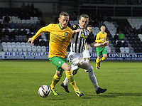 Adam Brown challenging John Herron in the St Mirren v Celtic Scottish Professional Football League Under 20 match played at St Mirren Park, Paisley on 30.4.14.