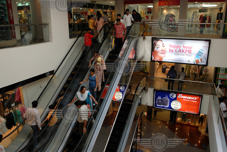 Shoppers use an escalator in a shopping centre in the Salt Lake suburb of the city.