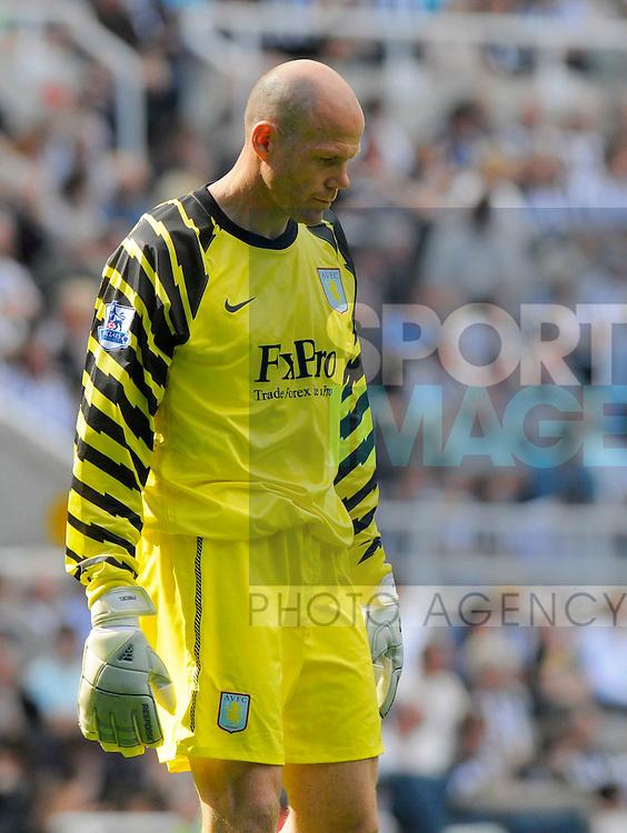Aston Villa's Brad Friedel looks dejected after conceding six goals.