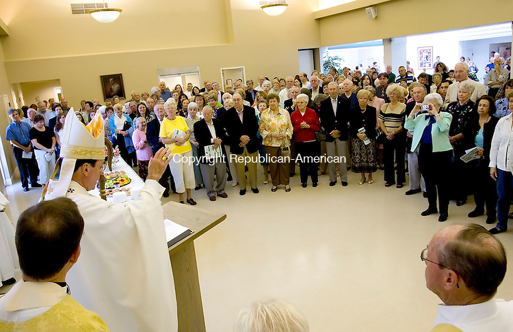 SOUTHBURY, CT-10 SEPTEMBER 2006-091006JS01-Archbishop Henry Mansell, the Archbishop of Hartford, left, blesses the Sacred Heart church expansion and parish center Sunday during a ceremony at the Sacred Heart Church in Southbury. -Jim Shannon Republican-American