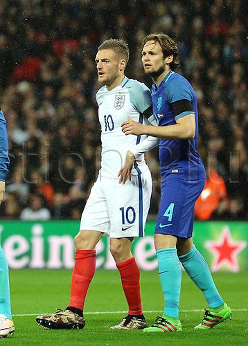 29.03.2016. Wembley Stadium, London, England.  International Football Friendly England versus Netherlands. England Forward Jamie Vardy and Netherlands Defender Daley Blind jostle during an England corner
