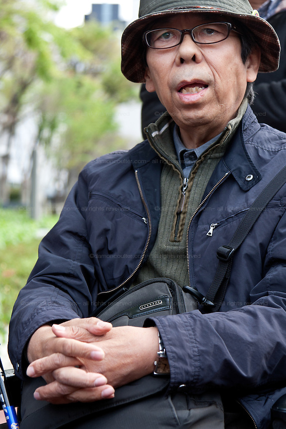 Hiroaki Yamada talks with protestors after his meeting with METI officials at the Occupy Kasumigasaki Camp outside the METI building in Kasumigaseki, Tokyo, Japan. Friday April 12th 2013