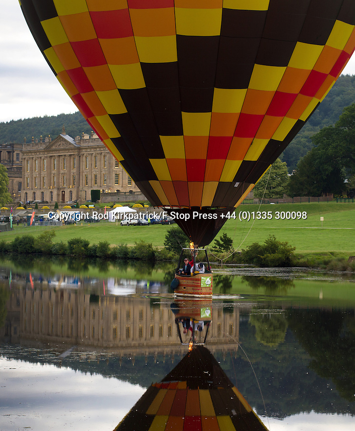 """04/09/15<br /> <br /> ***WITH VIDEO***<br /> <br /> Splash down!<br /> <br /> Hot air balloon pilots attempt to dip their baskets into the river Derwent before taking off again above Chatsworth House.  A mass launch at dawn this morning marked the start of the three-day Chatsworth Country Fair in the Derbyshire Peak District.<br /> <br /> A Chatsworth park ranger said: """"They try to do it every year, but I've only ever seen one manage it before - they need conditions to be perfect - I think it's like the holy grail for the pilots""""<br /> <br /> Another crew member shouted down from his basket that his pilot didn't want to get his new shoes wet after failing to get low enough for a splash-down.<br /> <br /> <br /> All Rights Reserved: F Stop Press Ltd. +44(0)1335 418629   www.fstoppress.com."""