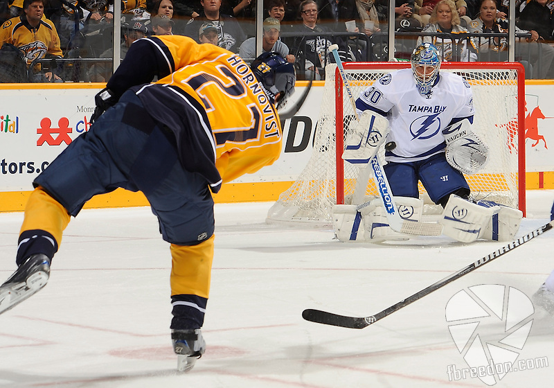 NASHVILLE, TN - OCTOBER 27:  Patric Hornqvist #27 of the Nashville Predators takes a shot on goalie Dwayne Roloson #30 of the Tampa Bay Lightning at Bridgestone Arena on October 27, 2011 in Nashville, Tennessee.  (Photo by Frederick Breedon/Getty Images)
