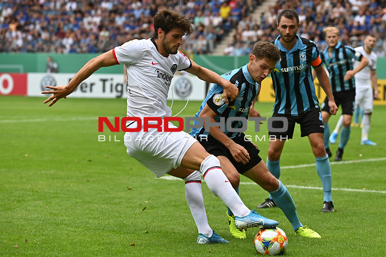 11.08.2019, Carl-Benz-Stadion, Mannheim, GER, DFB Pokal, 1. Runde, SV Waldhof Mannheim vs. Eintracht Frankfurt, <br /> <br /> DFL REGULATIONS PROHIBIT ANY USE OF PHOTOGRAPHS AS IMAGE SEQUENCES AND/OR QUASI-VIDEO.<br /> <br /> im Bild: Goncalo Paciencia (Eintracht Frankfurt #39), Marco Schuster (SV Waldhof Mannheim #6)<br /> <br /> Foto © nordphoto / Fabisch