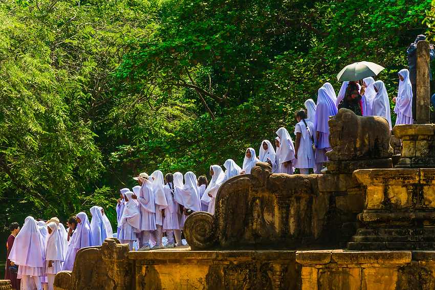 Muslim school girls, Sacred Quadrangle, Ruins of ancient city, Polonnaruwa, Sri Lanka.
