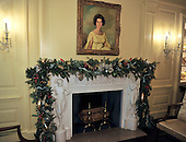 Fireplace garland in the Vermeil Room under the portrait of first lady Lady Bird Johnson that is part of the 2012 White House Christmas decorations in Washington, DC on Wednesday, November 28, 2012..Credit: Ron Sachs / CNP