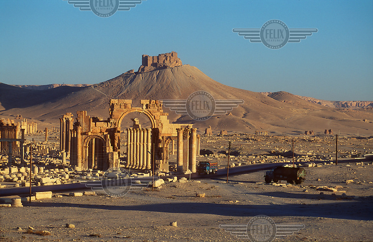 A view of the ancient ruins of Palmyra (or Tadmor in Arabic) with the Arab Fakhr-al-Din al-Ma'ani Castle on a hill behind. The site dates back to the Neolithic period and was first mentioned in the second millennium BC as a caravan stop. It later came under the Seleucid Empire and then under the Roman Empire.<br /> In May 2015 Islamic State (IS) forces fighting the Syrian government of President Assad took control of the modern settlement of Tadmur and the historic site. There are fears that the priceless treasures could fall victim to IS's iconoclastic destruction that has seen museums and ancient sites across Syria and Iraq destroyed.