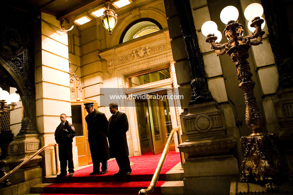 11 January 2006 - New York City, NY - Plaza hotel doorman Ed Trinka (C) awaits visitors in the entrance to the landmark hotel which is currently under renovation, 11 January 2006, New York City, USA. Trinka has been doorman at the Plaza since 1963.