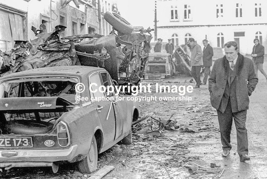 Plain-clothes Gardai, Irish policemen, at scene of UVF explosion in the centre of Belturbet, Co Cavan, Rep of Ireland, in which there were two fatalities, a 14 year old girl, Geraldine O&rsquo;Reilly and a 16 year old youth, Patrick Stanley. 28th December 1072. 197212280803A<br />