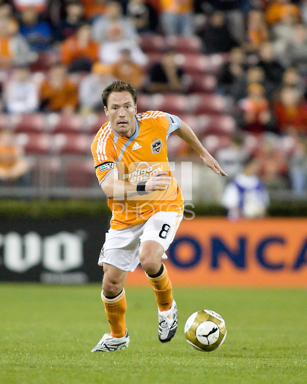 Houston Dynamo defender Richard Mulrooney (8) dribbles the ball.  Houston Dynamo tied Atlante FC 1-1 at Robertson Stadium in Houston, TX on February 24, 2009 in CONCACAF Champions League play .  Photo by Wendy Larsen/isiphotos.com