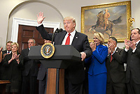 United States President Donald J. Trump waves after making remarks prior to signing an Executive Order to promote healthcare choice and competition in the Roosevelt Room of the White House in Washington, DC on Thursday, October 12, 2017.  The President's controversial plan is designed to make lower-premium health insurance plans more widely available.<br /> Credit: Ron Sachs / Pool via CNP /MediaPunch