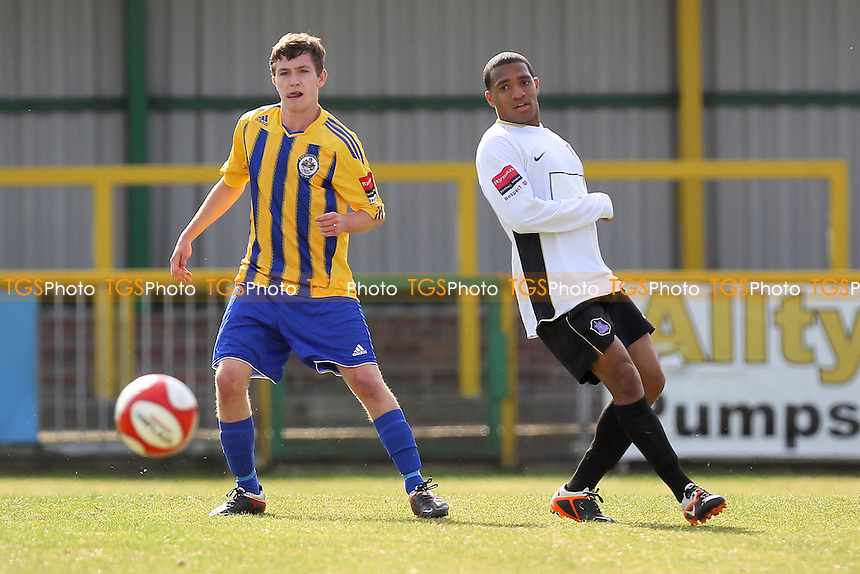 Joes Oates of Romford slides the ball past Kevin James of Dulwich - Romford vs Dulwich Hamlet - FA Trophy 1st Qualifying Round Football at Ship Lane, Thurrock FC - 15/09/12 - MANDATORY CREDIT: Gavin Ellis/TGSPHOTO - Self billing applies where appropriate - 0845 094 6026 - contact@tgsphoto.co.uk - NO UNPAID USE.