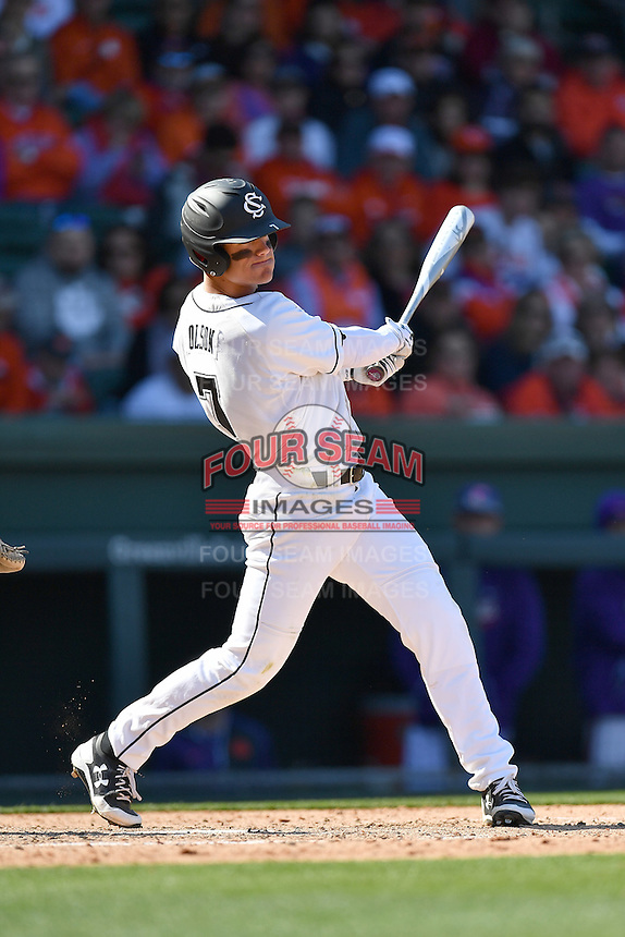 Right fielder Jacob Olson (7) of the South Carolina Gamecocks hits a triple in the Reedy River Rivalry game against the Clemson Tigers on Saturday, March 4, 2017, at Fluor Field at the West End in Greenville, South Carolina. Clemson won, 8-7. (Tom Priddy/Four Seam Images)