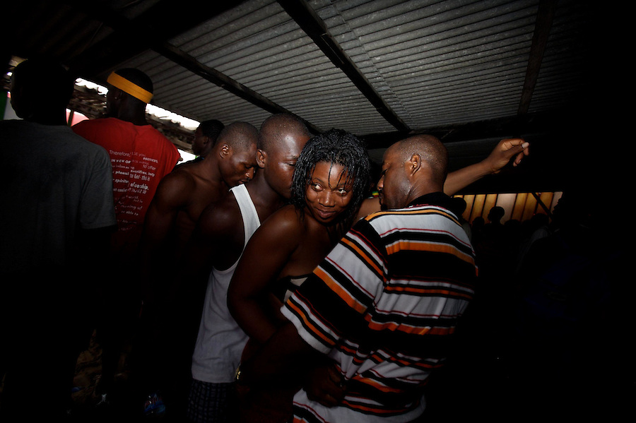Ghanaians  dance in a club while celebrating  their so long waited 50th anniversary of their countries' independence in Accra, Ghana on Wednesday March 07 2007..