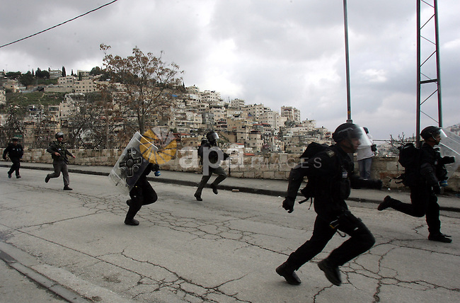 Israeli security officer shot a tear gas canister towards Palestinian stone-throwers, not pictured, during clashes in the east Jerusalem neighborhood of Silwan, Friday, March 11, 2011. Photo by Mahfouz Abu Turk