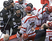 Buddy Powers (BU - Assistant Coach) reaches out to pull back Max Nicastro (BU - 7).  Steven Shamanski (PC - 28), Chris Rooney (PC - 21) - The Boston University Terriers defeated the visiting Providence College Friars 6-1 on Friday, January 20, 2012, at Agganis Arena in Boston, Massachusetts.