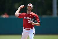 North Carolina State Wolfpack starting pitcher Johnny Piedmonte (33) warms up between innings of the game against the Army Black Knights at Doak Field at Dail Park on June 3, 2018 in Raleigh, North Carolina. The Wolfpack defeated the Black Knights 11-1. (Brian Westerholt/Four Seam Images)
