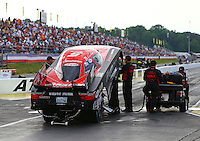 May 15, 2015; Commerce, GA, USA; Crew members wait to start the engine for NHRA funny car driver Cruz Pedregon during qualifying for the Southern Nationals at Atlanta Dragway. Mandatory Credit: Mark J. Rebilas-USA TODAY Sports