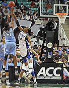 Jessica Breland (51) shoots over Duke's Karima Christmas (13). This was the Championship game of the 2011 ACC Tournament in Greensboro on March 6, 2011. Duke beat UNC 81-66. (Photo by Al Drago)