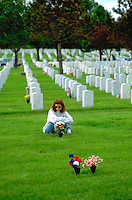 Woman age 25 remembering fallen soldier on Memorial Day.  Minneapolis Minnesota USA