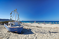 A boat on the beach of Plaka in Naxos island, Greece