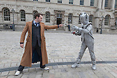 London, UK. 27 April 2014. The Doctor fights a Cyberman. Sci-Fi fans gathered in the Courtyard of Somerset House, London, and dressed up as their favourite science fiction character ahead of a parade through London. This 4th annual parade was organised by Sci-Fi London 14, the London International Festival for Science Fiction and Fantastic Film which runs unil May 4th.