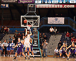 SIOUX FALLS, SD - MARCH 10:  Stefanie Mauk #3 from Western Illinois knocks down a three pointer over a pair of defenders including Michelle Maher #14 from IPFW in the second half of their quarterfinal game Sunday afternoon at the 2013 Summit League Championships in Sioux Falls, SD. The shot tied the game at the end of regulation with IPFW winning 106-101 in double overtime. (Photo by Dave Eggen/Inertia)