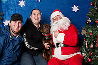 Dan Adams and his dog Brie, pose for a holiday photo with Santa at Pet Pros in Redmond, WA to help raise money for Dogs Deserve Better on December 11, 2010. (photo by Karen Ducey)