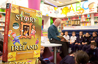 "*** NO FEE PIC***.01/03/2012.Pictured is Irish Author Brendan O' Brien with third class children from Holy Cross National School Dundrum, Dublin at a free reading event of his book "" The Story of Ireland"" in Eason Dundrum to celebrate the 15th annual World Book Day. To celebrate World Book Day Eason, Ireland's leading retailerof books, stationery, magazines & More have teamed up with some of Ireland'sleading children's writers to deliver a series of events in key stores to mark World Book Day..Photo: Gareth Chaney Collins"