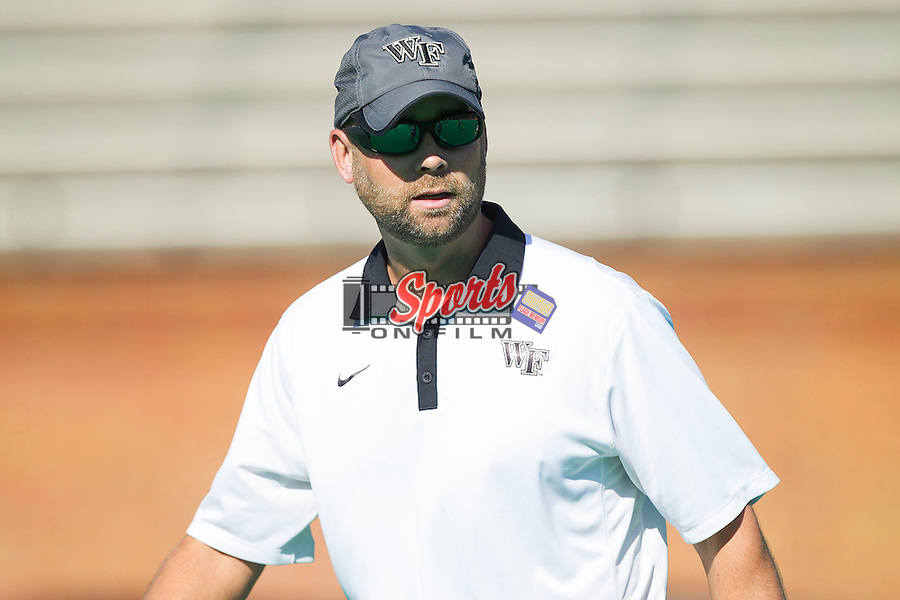 Wake Forest Demon Deacons assistant coach Rich Sutton watches her team go through pre-game drills prior to taking on the Liberty Flames at Kentner Stadium on September 13, 2013 in Winston-Salem, North Carolina.  The Demon Deacons defeated the Flames 3-2.  (Brian Westerholt/Sports On Film)