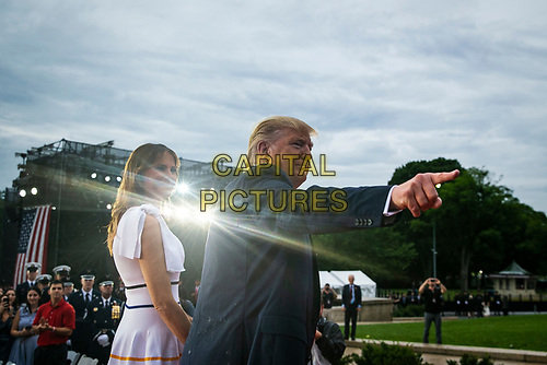"U.S. President Donald Trump points as he departs with first lady Melania Trump during the Fourth of July Celebration 'Salute to America' event in Washington, D.C., U.S., on Thursday, July 4, 2019. The White House said Trump's message won't be political -- Trump is calling the speech a ""Salute to America"" -- but it comes as the 2020 campaign is heating up. <br /> h<br /> CAP/MPI/CNP<br /> ©CNP/MPI/Capital Pictures"