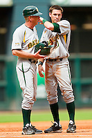 Jake Miller #20 of the Baylor Bears gives his helmet to third base coach Steve Johnigan after making the final out of an inning against the Houston Cougars at Minute Maid Park on March 4, 2011 in Houston, Texas.  Photo by Brian Westerholt / Four Seam Images