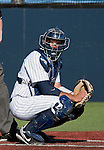 February 24, 2012:   Nevada Wolf Pack catcher Carlos Escobar looks for a sign from his coach against the Utah Valley Wolverines during their NCAA baseball game played at Peccole Park on Friday afternoon in Reno, Nevada.
