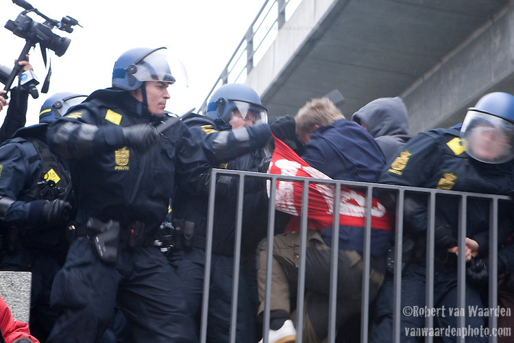 The Danish Police beat back delegates and civil society that have walked out of the COP 15 to join the larger demonstration outside. (Images provided for editorial web usage for members of the Fresh Air Center during COP 15)