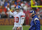 Landover, MD - November 30, 2008 -- New York Giants quarterback Eli Manning (10) points skyward as he listens to head coach Tom Coughlin's instructions late in the second quarter against the Washington Redskins at FedEx Field in Landover, Maryland on Sunday, November 30, 2008..Credit: Ron Sachs / CNP.(RESTRICTION: No New York Metro or other Newspapers within a 75 mile radius of New York City)