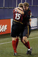 The  MetroStars' Eddie Gaven hugs teammate John Wolyniec, after Wolyniec scored what turned out to be the games only goal in the 72nd  minute. The Kansas City Wizards were defeated by  the NY/NJ MetroStars to a 1 to 0 at Giant's Stadium, East Rutherford, NJ, on May 30, 2004.