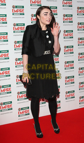 LOIS WINSTONE.The Jameson Empire Film Awards, Grosvenor House Hotel, Park Lane, London, England..March 28th 2010.full length black jacket dress tights bolero buttons silver clutch bag peep toe shoes hand palm.CAP/ROS.©Steve Ross/Capital Pictures..
