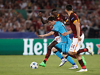 Calcio, Champions League, Gruppo E: Roma vs Barcellona. Roma, stadio Olimpico, 16 settembre 2015.<br /> FC Barcelona&rsquo;s Lionel Messi, center, is challenged by Roma&rsquo;s Antonio Ruediger, left, and Kostas Manolas, during a Champions League, Group E football match between Roma and FC Barcelona, at Rome's Olympic stadium, 16 September 2015.<br /> UPDATE IMAGES PRESS/Isabella Bonotto