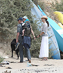 5-25-09.minnie driver walking on the beach with baby henry and random guy..AbilityFilms@yahoo.com.805-427-3519.www.AbilityFilms.com