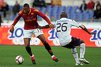 Calcio, Serie A: Roma vs Bologna. Roma, stadio Olimpico, 1 novembre 2009..Football, Italian serie A: Roma vs Bologna. Rome, Olympic stadium, 1 november 2009. AS Roma forward Julio Baptista, of Brazil, left, in action as Bologna midfielder Gaby Mudingayi, of Belgium, tries to stop him..UPDATE IMAGES PRESS/Riccardo De Luca