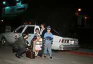 Tijuana, Mexico. January, 1983. <br /> Many Mexican families attempt to cross the border with their children at night. Using night vision devices the border patrol catches them, arrests them, and immediately deports them back to Mexico.