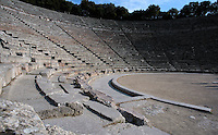 EPIDAURUS, GREECE - APRIL 14 : A detail of the Orchestra and Cavea of the Theatre, on April 14, 2007 in Epidaurus, Greece. The Theatre, designed by Polykleitos the Younger, was built in the late 4th century BC and extended in the Hellenistic period. It was rediscovered in 1881 and significantly restored in the 1950s.  It has the three main features of a Greek theatre: the orchestra, a sunken round stage surrounded by a paved drainage depression; the skene, and the cavea, a raked semi-circular auditorium with radiating diazomas. The theatre is renowned for its accoustics thanks to the symmetry of the cavea, seen here in the evening light and shadow. (Photo by Manuel Cohen)