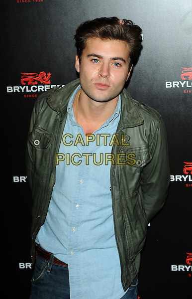 MICHAEL WOODS.The Brylcreem Ball - launch party,.Vendome, London, England..October 27th, 2010.half length blue shirt green leather jacket.CAP/CJ.©Chris Joseph/Capital Pictures.