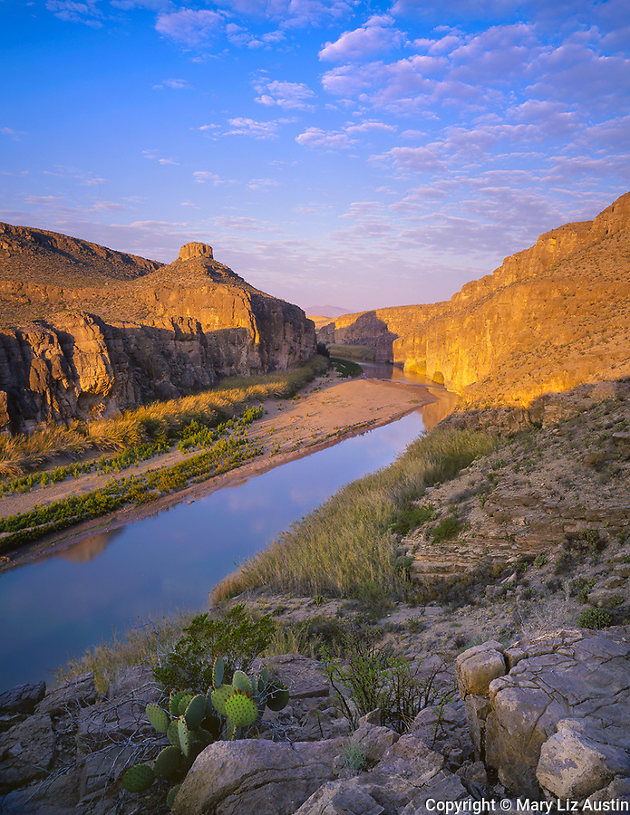 Big Bend National Park, TX<br /> Rio Grande River flowing under the limestone cliffs of Hot Springs Canyon