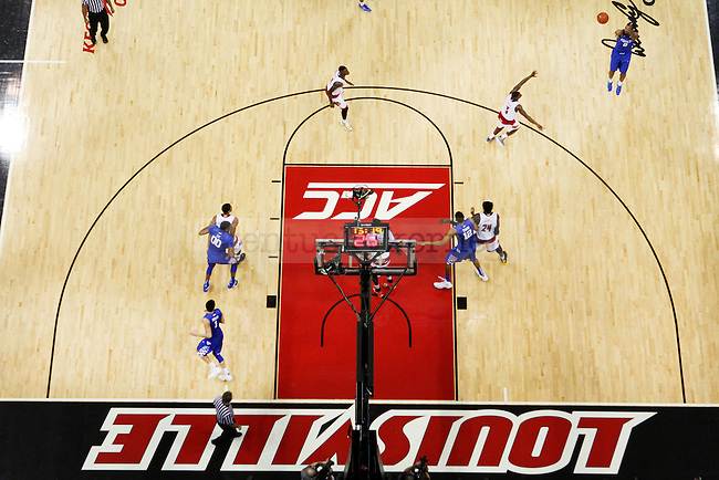 Guard Aaron Harrison of the Kentucky Wildcats shoots a three during the game against  the Louisville Cardinals at KFC Yum! Center on Saturday, December 27, 2014 in Louisville `, Ky. Kentucky defeated Louisville 58-50. Photo by Michael Reaves | Staff