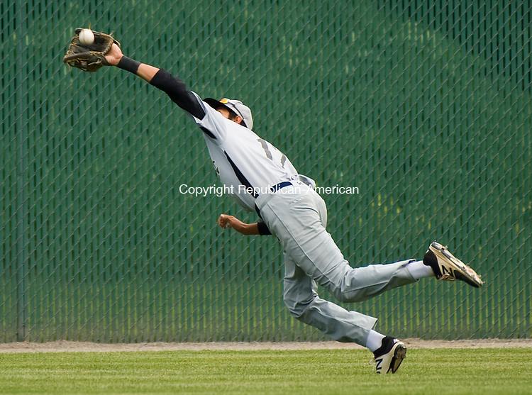 WATERBURY, CT-0712917JS05-- Colton's Elias Rios (17) makes a diving catch in center field during their Mickey Mantle World Series game against Ontario Saturday at Municipal Stadium in Waterbury. <br /> Jim Shannon Republican-American