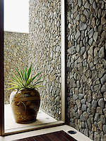 Walls of gathered stone - rough, tumbled smooth and lichen encrusted - are a feature of the property
